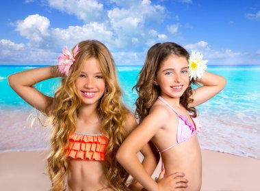 children two friends girls happy in tropical beach vacation