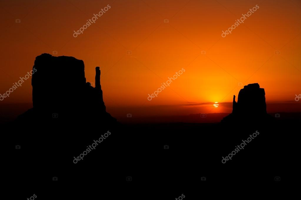 Sunrise at Monument Valley West and East Mittens Butte