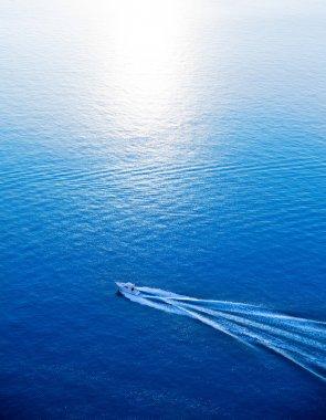 Boat cruising blue Mediterranean sea aerial view