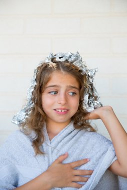 Funny kid girl scared about his dye hair with foil