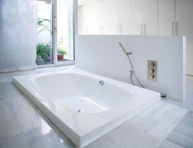 Modern white house bathroom bathtub with courtyard skylight