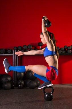 kettlebell woman pistol squat  balance at gym