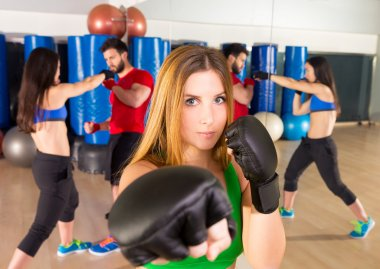 Boxing aerobox woman portrait in fitness gym