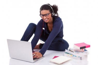 Young African student girl using a computer