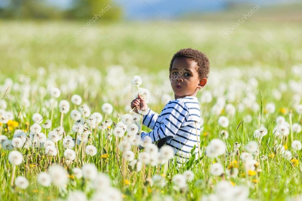 Cute african american little boy playing outdoor - Black people