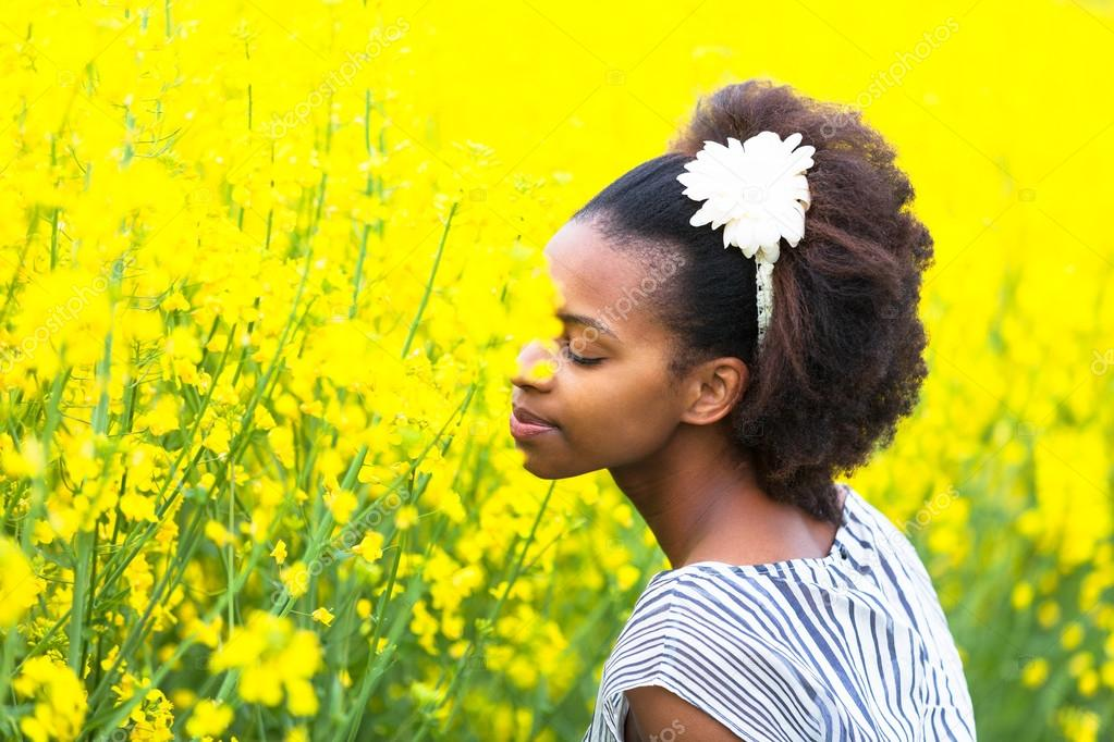 Outdoor portrait of a young beautiful african american woman in