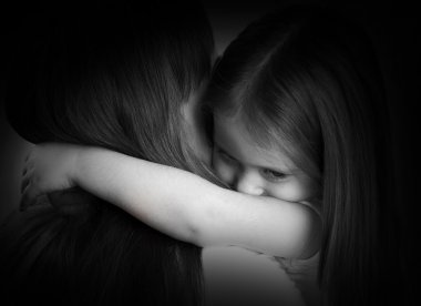 black and white portrait of a sad little girl and her mother