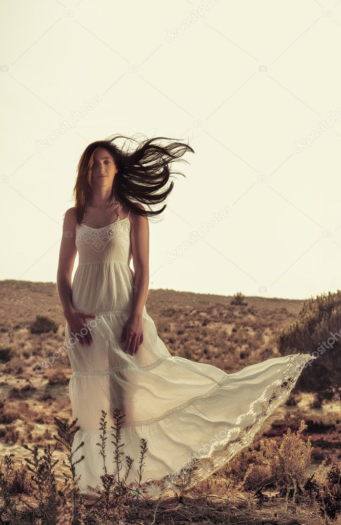 Girl with white dress in the forest