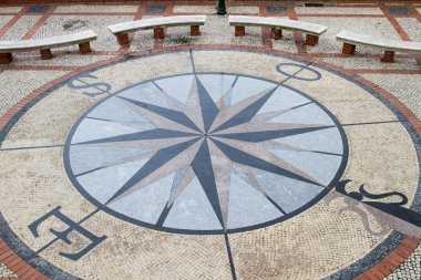 Stone pavement mosaic of a wind rose