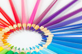 Circle of colored pencils for creativity on a white background