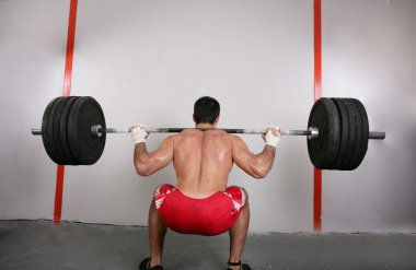 The concept of power and determination of a man lifting a weight