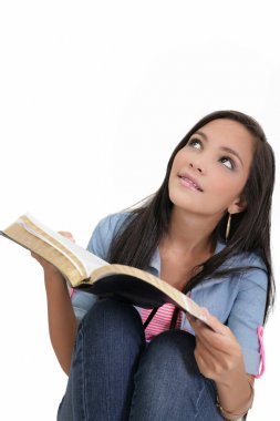 Beautiful young woman holding a Bible