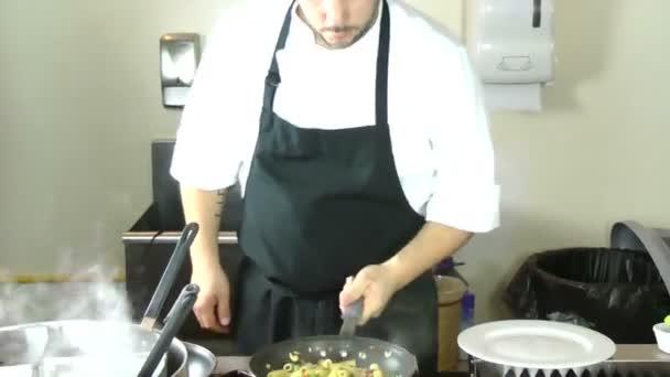 Male chef preparing tasty food in kitchen