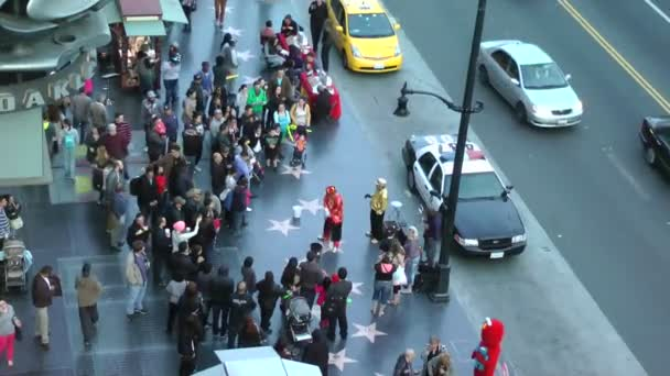 LOS ANGELES - CIRCA 2014: People walking on famous Walk of Fame at Hollywood Blvd on CIRCA 2014 in Los Angeles, California.