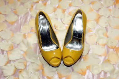 a pair of yellow high-heeled shoes