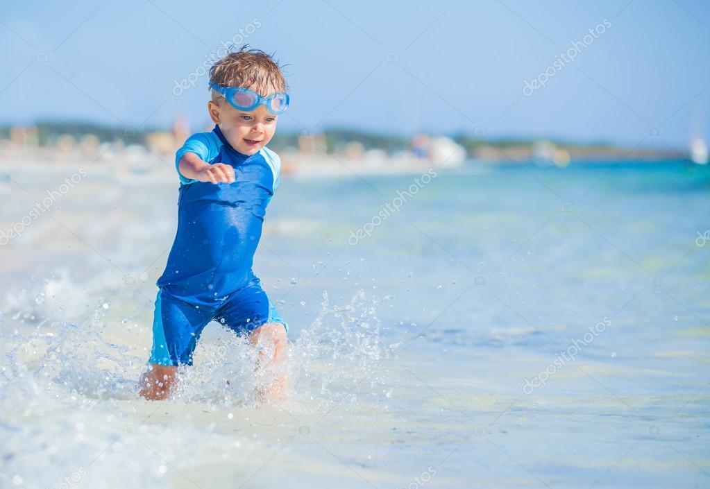 Cute boy on the beach