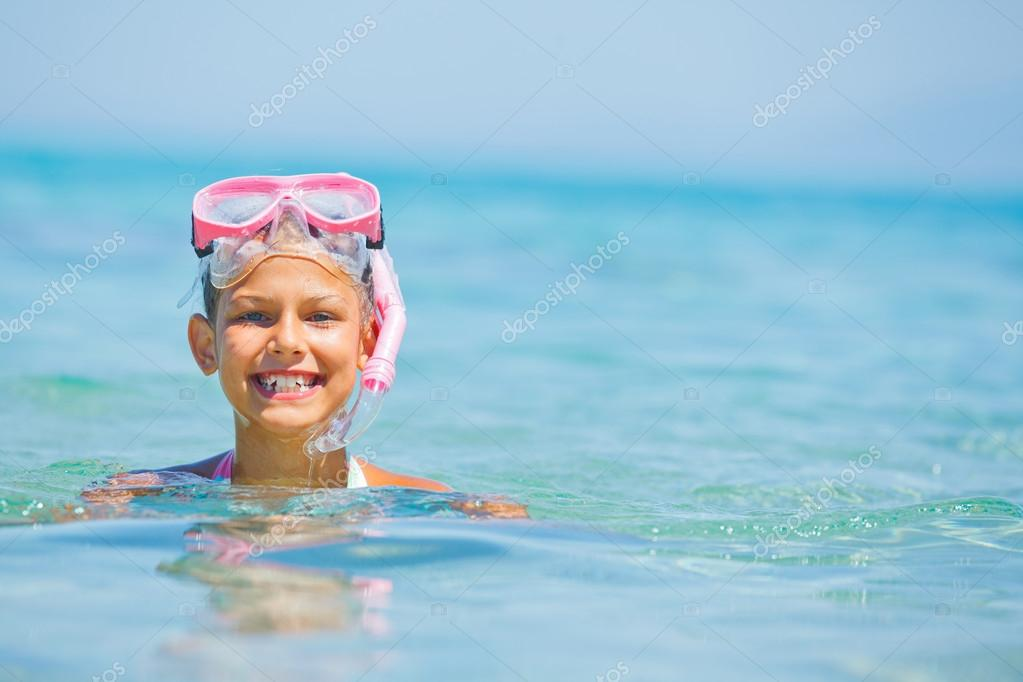 Cute girl playing in the sea