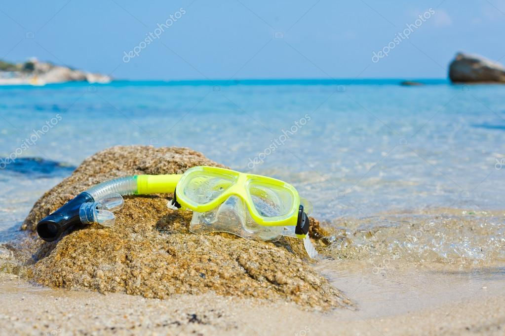 Snorkel and mask on the beach.