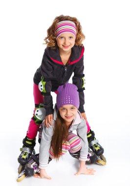 Two cute girls in roller skates