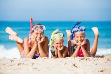 three happy children on beach...