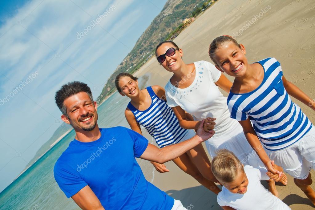 Family having fun on beach