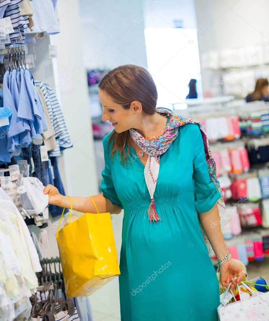 a610f3c92 Pregnant woman in baby shop store — Stock Photo © mac sim  44850733