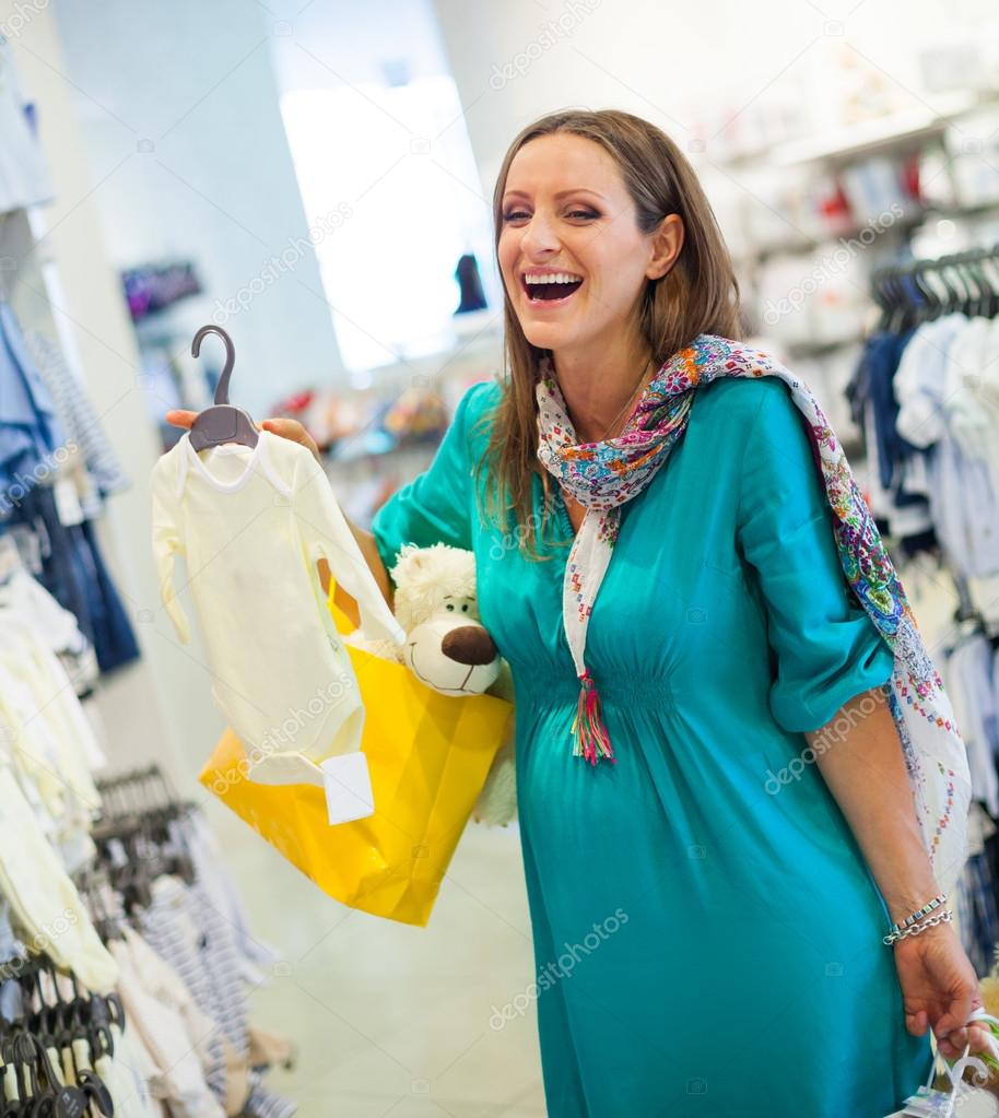d46b7403a Pregnant woman in baby shop store — Stock Photo © mac sim  44851609