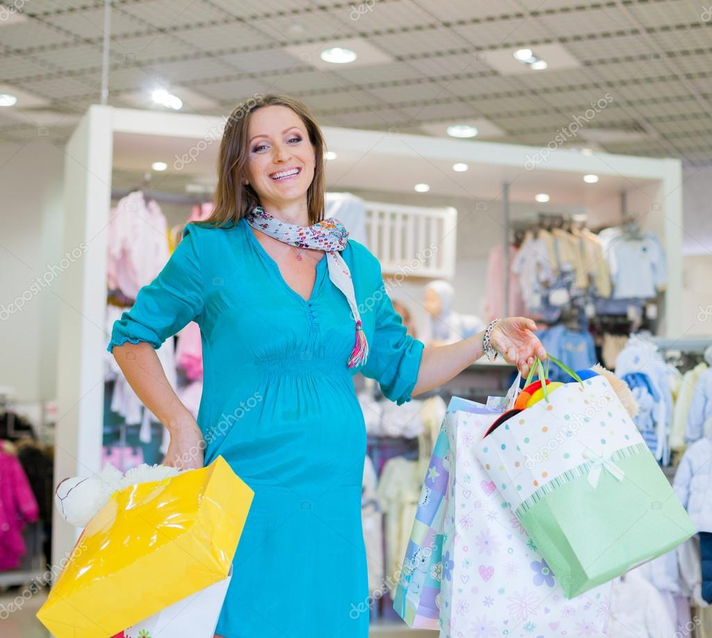 3380a0e3a Pregnant woman in baby shop store — Stock Photo © mac sim  44866493