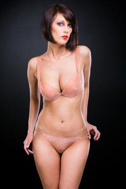 young woman in beige elegant lacy underwear