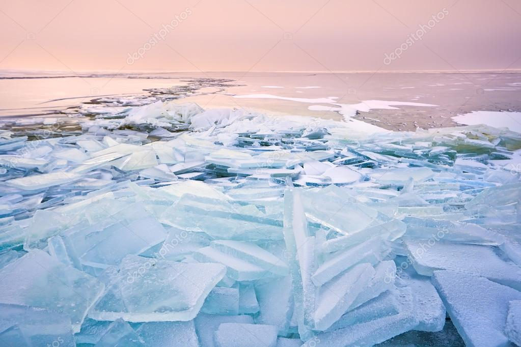 broken shelf ice pieces at sunset on North sea