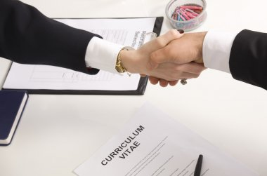 woman shaking hands with manager at job interview closeup