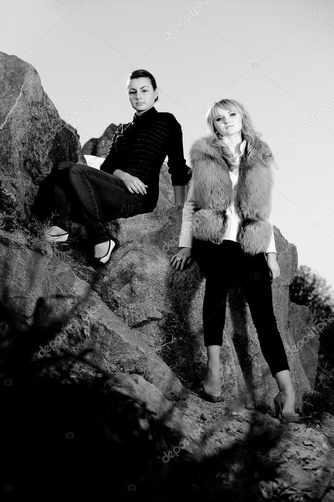 Black and white photo of sexy girls on rocks
