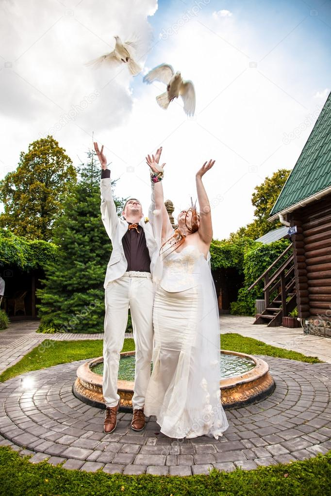 Married Couple Letting Out Two White Pigeons Stock Photo 33524797