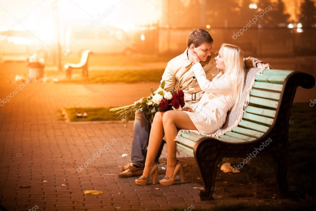 couple in love hugging on bench