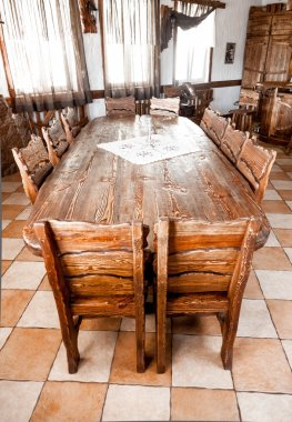 Round table in dining room with wooden chairs