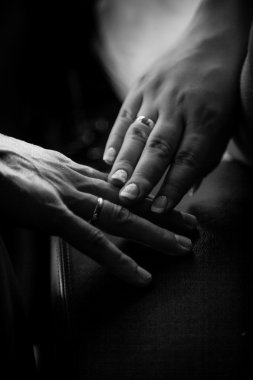 closeup photo of bride and groom touching hands