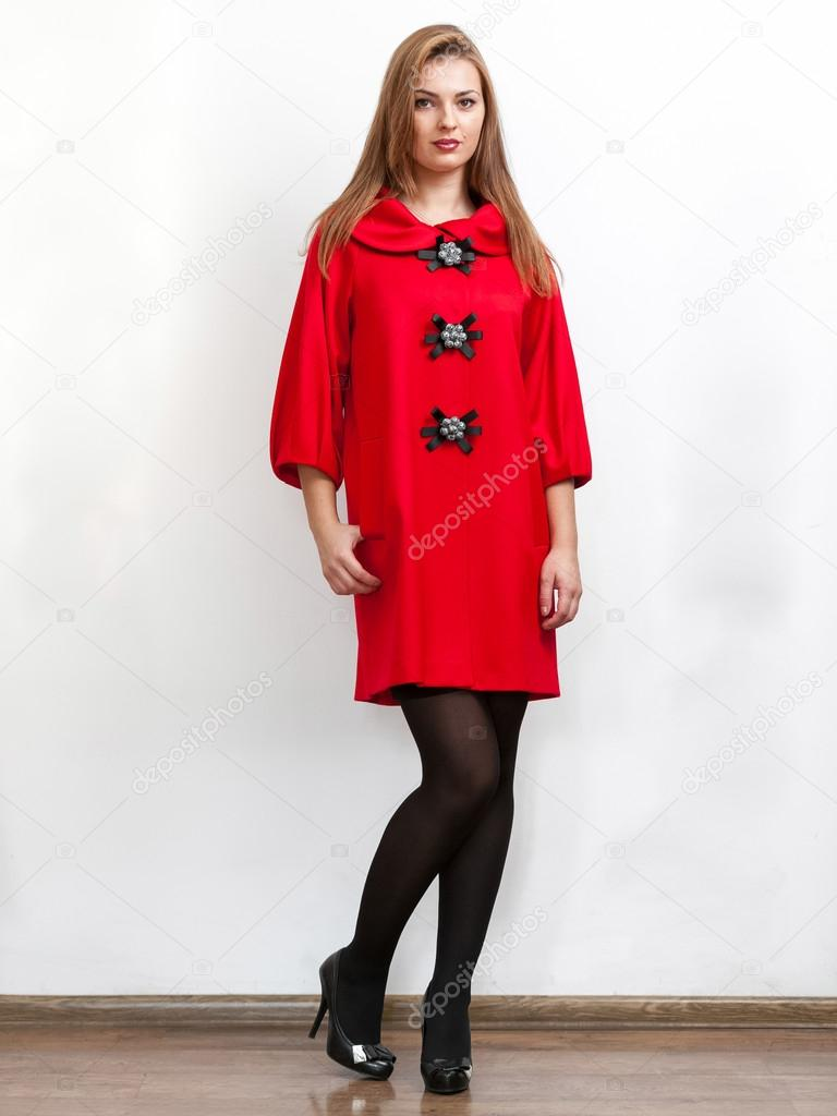 Woman wearing cute red coat with short sleeves and big buttons ...