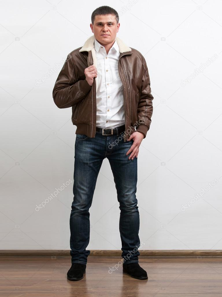 Handsome man in white shirt with unzipped leather jacket for Man in white shirt