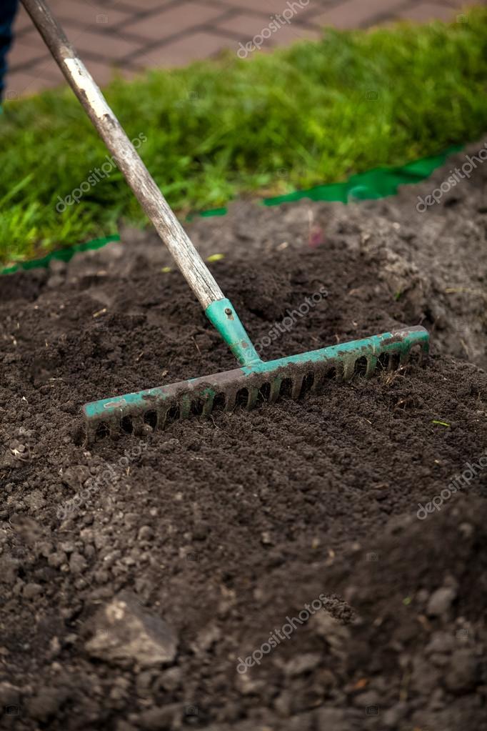 photo of rake on garden bed