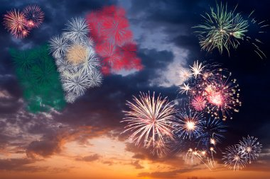 Holiday fireworks with national flag of Mexico