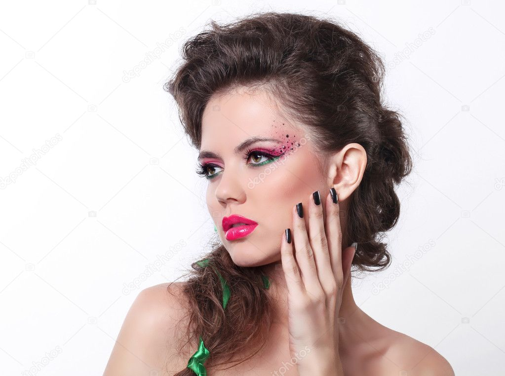 Portrait of sexy beautiful woman with bright make-up and curly h