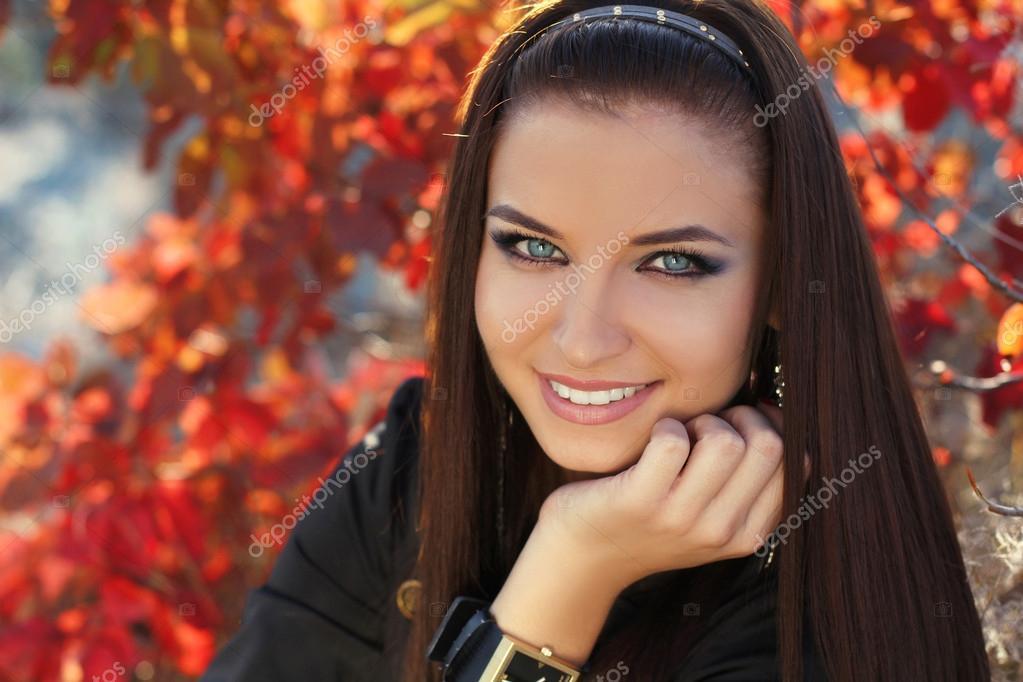 Happy smiling brunette girl. Autumn Woman Fashion Portrait.
