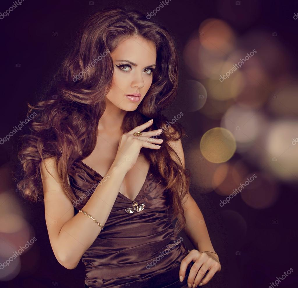 Fashion lady, sensual brunette woman with shiny curly silky hair