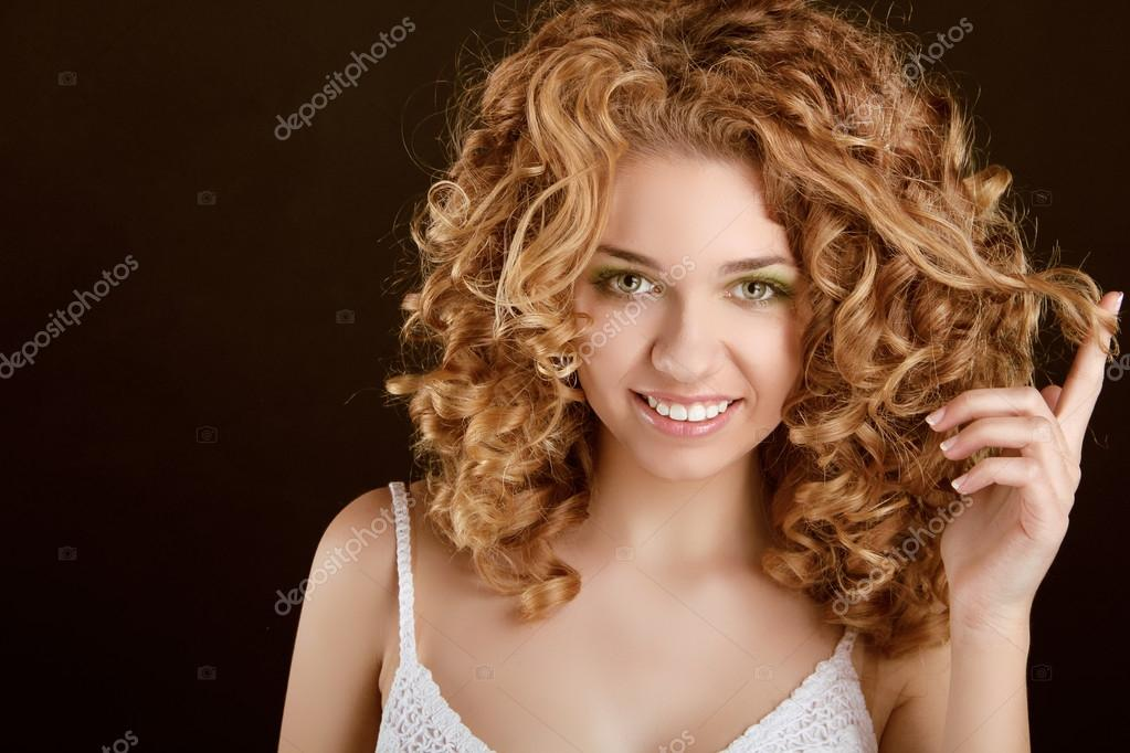 Attractive smiling teen girl with Curly Hair wavy hair, curl on