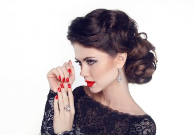 Fashion Portrait Of Beautiful Girl with red nails and lips. Vogu