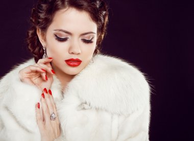 Glamour portrait of beautiful woman model in luxury fur coat ov
