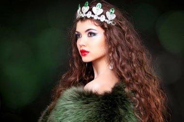 Beautiful woman luxury portrait with long hair in fur coat. Jewe