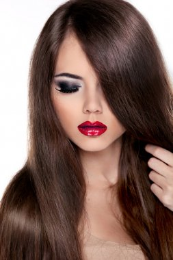 Beautiful Brunette Girl with Healthy Long Hair and Red Lips. Fa