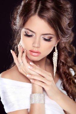 Beautiful bride woman portrait in white dress. Fashion Beauty Gi