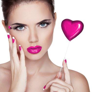 Bright makeup. Beauty Portrait. Beautiful Woman Touching her Fa